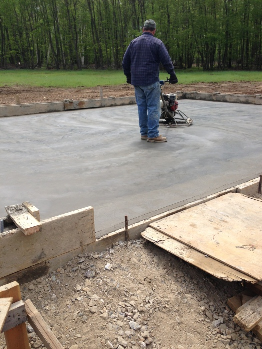 Power troweling the garage slab.