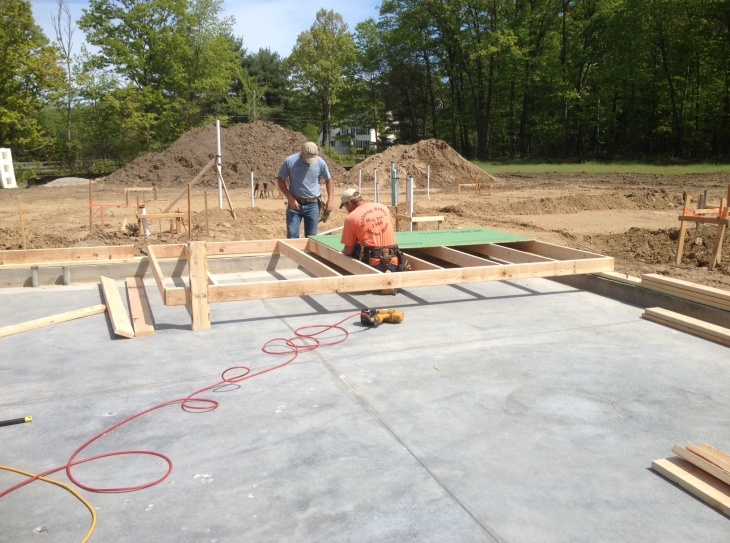 The first wall section for the garage being assembled.