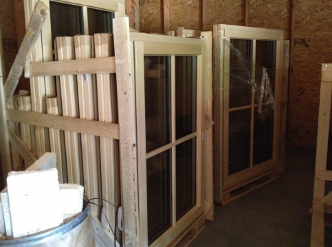 The windows survived the long sail from Germany screwed into pallets, and will remain that way until they are installed in a couple weeks.