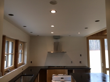 Testing four kinds of recessed lighting trims.