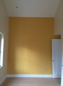 Girls' room paint: one yellow wall.